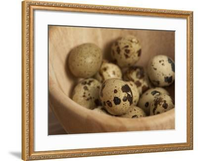 Exotic Bird Eggs in Wooden Bowl on Table--Framed Photographic Print