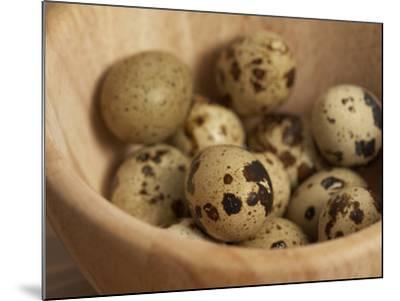 Exotic Bird Eggs in Wooden Bowl on Table--Mounted Photographic Print