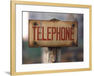 Close-Up of Singed Telephone Sign Outdoors--Framed Photographic Print