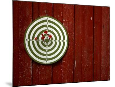 Old Dart Board Game Hanging on a Weathered Red Wall--Mounted Photographic Print