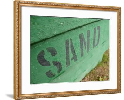 Sand Painted on Bright Green Wood Plank Wall--Framed Photographic Print