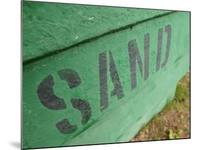 Sand Painted on Bright Green Wood Plank Wall--Mounted Photographic Print