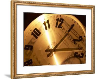 Clear Clock with Black Numbers and Hands with Reflection of American Dollar Bill--Framed Photographic Print