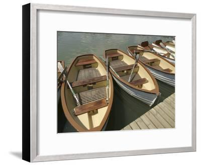 Rowboats with Oars Alongside a Dock--Framed Photographic Print