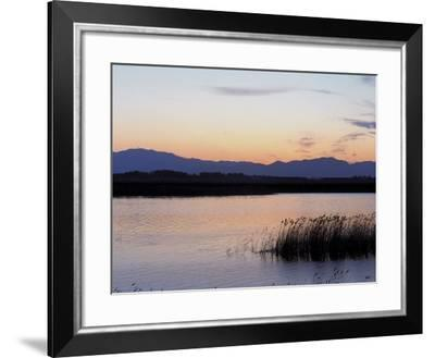 Sunset over a Peaceful Lake with Silhouette of Mountains--Framed Photographic Print