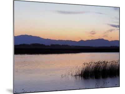 Sunset over a Peaceful Lake with Silhouette of Mountains--Mounted Photographic Print