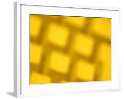 Unfocused Yellow Tinted Computer Keyboard--Framed Photographic Print