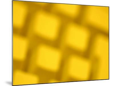 Unfocused Yellow Tinted Computer Keyboard--Mounted Photographic Print