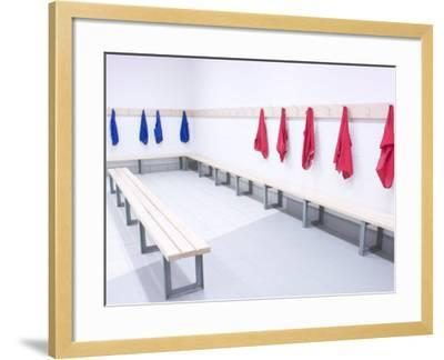 Blue and Red Shirts Hanging from Hooks in School Gym Change Room--Framed Photographic Print