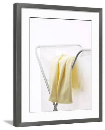 Yellow T-Shirt on Household Laundry Hamper--Framed Photographic Print