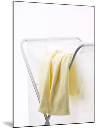Yellow T-Shirt on Household Laundry Hamper--Mounted Photographic Print