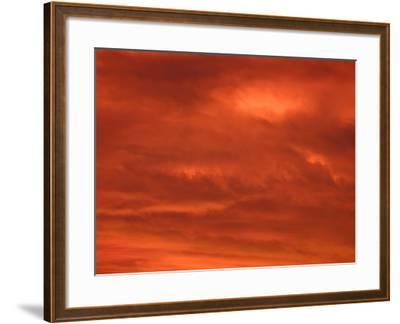 Fiery Red and Orange Sunset Illuminating the Night Sky--Framed Photographic Print
