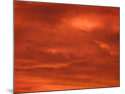 Fiery Red and Orange Sunset Illuminating the Night Sky--Mounted Photographic Print