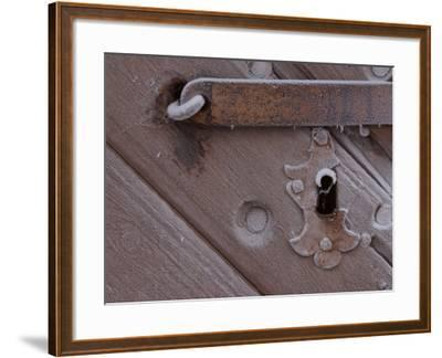 Metal Keyhole and Latch on Rustic Snow-Covered Wooden Door--Framed Photographic Print