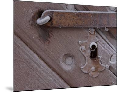 Metal Keyhole and Latch on Rustic Snow-Covered Wooden Door--Mounted Photographic Print