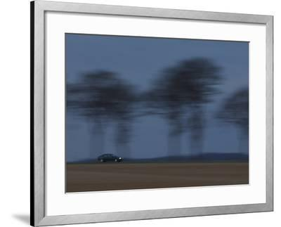 Motion Blur of Speeding Car on Tree-Lined Road in France--Framed Photographic Print