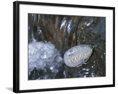 Stone with Word Imagine in Water of Tranquil Stream--Framed Photographic Print