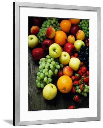 Pile of a Variety of Fruits Including Grapes and Oranges--Framed Photographic Print