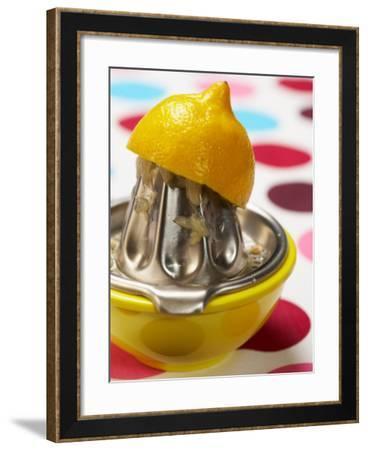 Juicer with Bowl and Lemon Half on Polka Dot Surface--Framed Photographic Print