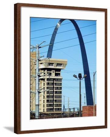Historical Gateway Arch Towering over Building in St. Louis, Missouri--Framed Photographic Print