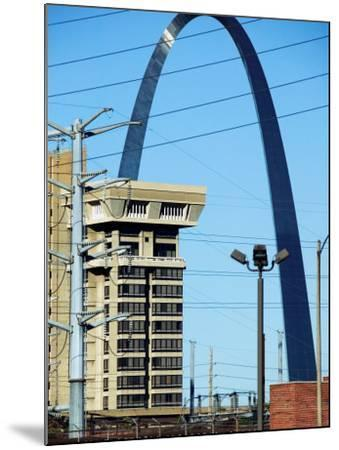 Historical Gateway Arch Towering over Building in St. Louis, Missouri--Mounted Photographic Print