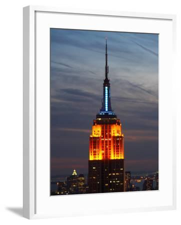 Top of the Empire State Building Illuminated at Night in New York City, New York--Framed Photographic Print