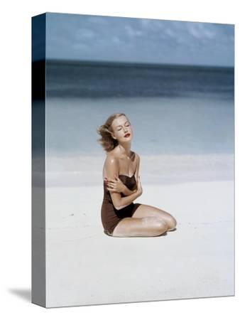 Vogue - July 1953 - Strapless Givenchy Swimsuit-John Rawlings-Stretched Canvas Print