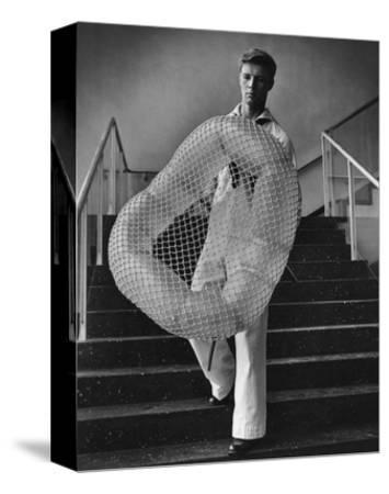 Vogue - July 1944 - William Miller Carrying a Chair he Designed-Karger-Pix-Stretched Canvas Print