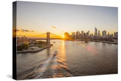 Usa, New York, Lower Manhattan Skyline and Brooklyn Bridge over East River at Sunset-Alan Copson-Stretched Canvas Print