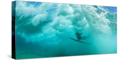 Female Surfer Pushes under a Wave While Surfing, Clansthal, South Africa--Stretched Canvas Print