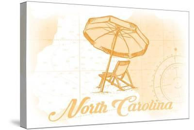 North Carolina - Beach Chair and Umbrella - Yellow - Coastal Icon-Lantern Press-Stretched Canvas Print