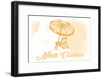 North Carolina - Beach Chair and Umbrella - Yellow - Coastal Icon-Lantern Press-Framed Art Print