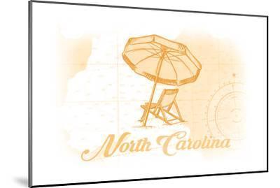 North Carolina - Beach Chair and Umbrella - Yellow - Coastal Icon-Lantern Press-Mounted Art Print