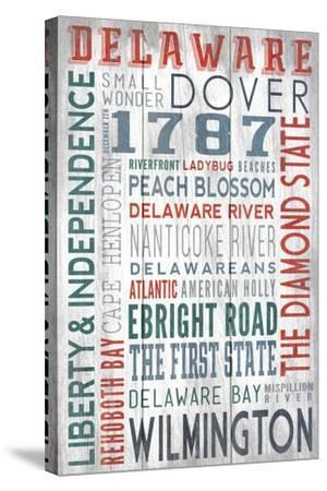 Delaware - Barnwood Typography-Lantern Press-Stretched Canvas Print