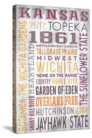 Kansas - Barnwood Typography-Lantern Press-Stretched Canvas Print