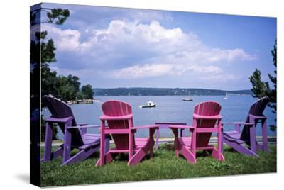 Canada, Nova Scotia, Mahone Bay, Colorful Adirondack Chairs Overlook the Calm Bay-Ann Collins-Stretched Canvas Print