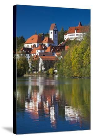 Germany, Bavaria, Fussen, St. Mang Abbey and the Hohes Schloss Castle from the Lech River-Walter Bibikow-Stretched Canvas Print
