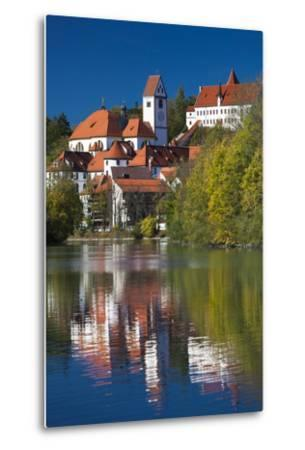 Germany, Bavaria, Fussen, St. Mang Abbey and the Hohes Schloss Castle from the Lech River-Walter Bibikow-Metal Print