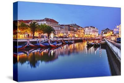Portugal, Aveiro, Moliceiro Boats Along the Main Canal of Aveiro-Terry Eggers-Stretched Canvas Print