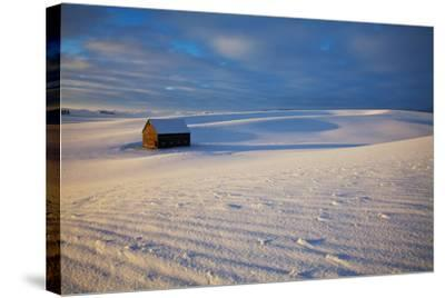 USA, Idaho, Small Barn in Snow Covered Field-Terry Eggers-Stretched Canvas Print