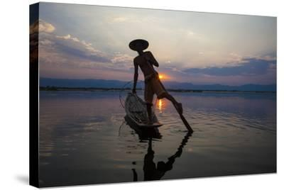 Myanmar, Inle Lake. Fisherman Rowing at Sunset-Jaynes Gallery-Stretched Canvas Print