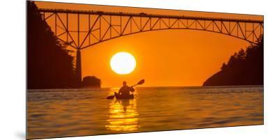 Washington, Woman Sea Kayaker Paddles before the Deception Pass Bridge at Sunset-Gary Luhm-Mounted Premium Photographic Print
