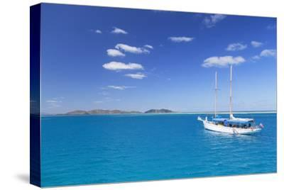 Yacht in Lagoon with Malolo Island, Mamanuca Islands, Fiji, South Pacific, Pacific-Ian Trower-Stretched Canvas Print