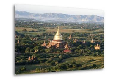 The Golden Stupa of Dhammayazika Pagoda Amongst Some Other Terracotta Buddhist Temples in Bagan-Annie Owen-Metal Print