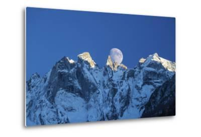 The Moon Appears Behind the Snowy Mountains Illuminating the Peaks-Roberto Moiola-Metal Print