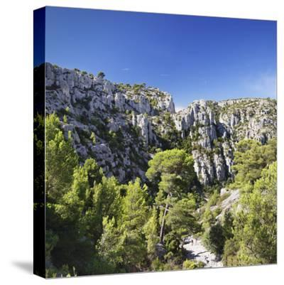 People Hiking Through Rocky Landscape of Les Calanques, Southern France-Markus Lange-Stretched Canvas Print