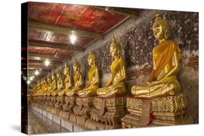 Rows of Gold Buddha Statues, Wat Suthat Temple, Bangkok, Thailand, Southeast Asia, Asia-Stephen Studd-Stretched Canvas Print