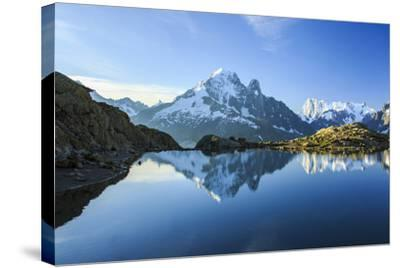 The Snowy Peaks of Mont Blanc are Reflected in the Blue Water of Lac Blanc at Dawn, France-Roberto Moiola-Stretched Canvas Print