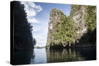 Rugged Limestone Islands Frame an Indonesian Pinisi Schooner-Stocktrek Images-Stretched Canvas Print