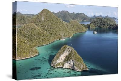 Forest-Covered Limestone Islands Surround a Lagoon in Raja Ampat-Stocktrek Images-Stretched Canvas Print